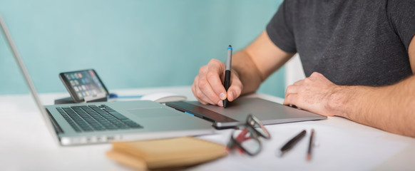 Graphic designer working using laptop