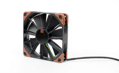 Computer black fan isolated on white background. Quiet cooling component of pc with anti-vabration pads. Hardware cooler.