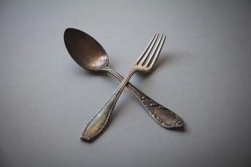 Crossed vintage forks and spoons