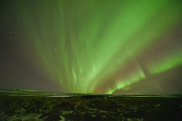 Aurora polaris above mountains.northern lights landscape