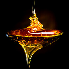 Abstract of Honey Pouring Into Spoon