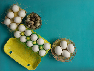 White chicken Chicken and quail eggs in colored paper eco-friendly packaging with  sisal Close-up photo Easter background