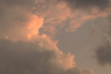 The orange light and clouds in the evening