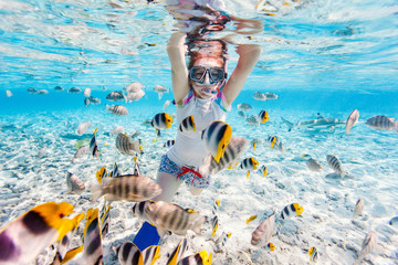 Woman snorkeling with tropical fish