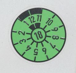 Grüne TÜV-Plakette