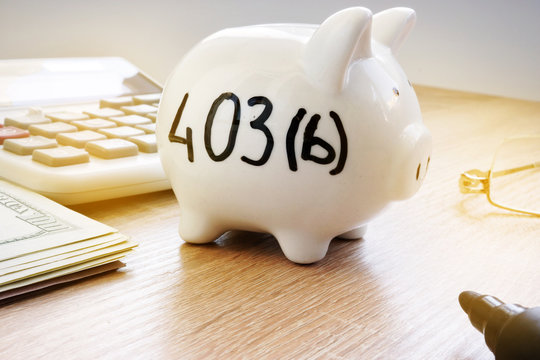 Piggy bank with sign 403b on a side. Retirement plan.