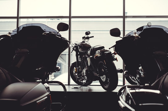 image of a new motorcycle in the store. Motorcycles and accessories in a modern motorcycle store. cool motorcycle in the motor cabin silhouette. The concept of motorcycles