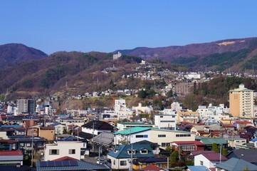 高島城天守閣から見た上諏訪駅周辺の町並み