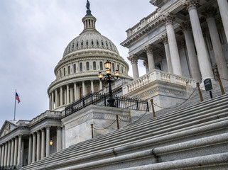 The United States capitol building with dark sclouds above