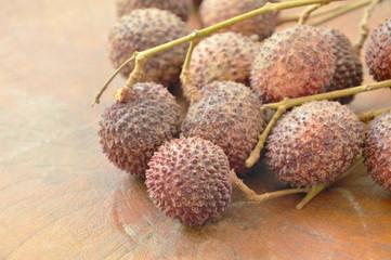 lychee tropical fruit on wooden board