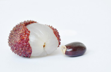lychee tropical fruit peel out and seed on white background