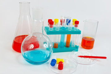 Tools and equipment for chemical experiments on a white background