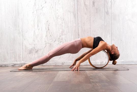 Young fit woman doing purvottanasana yoga pose