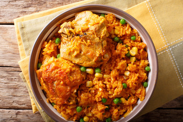 Galinhada is the Brazilian version of arroz con pollo chicken and rice close-up on a plate. horizontal top view