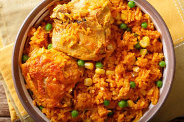 traditional spicy Brazilian food: chicken and rice close-up on a plate. horizontal top view
