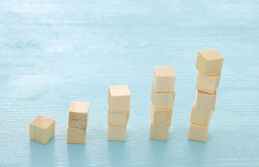 wooden blocks stacking as chart or ladder. concept for growth and success.