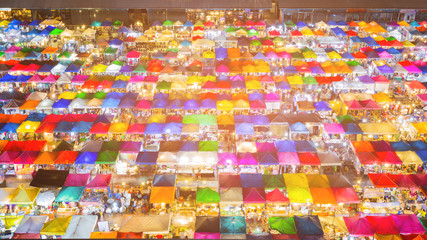 Night top view multiple colour flea market, cityscape background