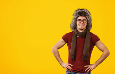Cheerful hipster in trendy fur hat