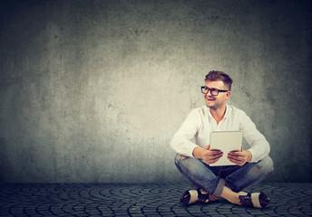 Modern man with laptop on floor