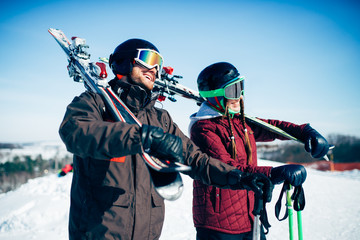 Skiers with skis and poles, extreme lifestyle
