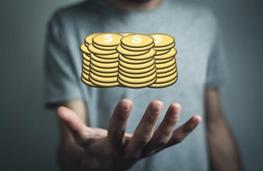 Man holding golden dollar coins.
