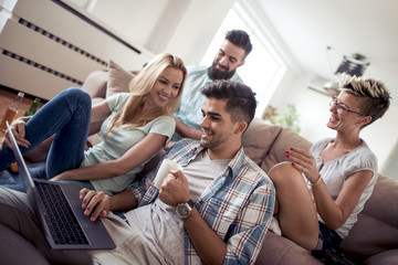 Group of friends sitting on the couch in living room