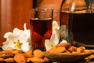 Amaretto liqueur, dry almonds and white flowers