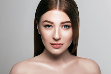 Beautiful woman face with fresh makeup, beauty healthy skin and perfect eyebrows