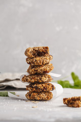 Vegan oatmeal cookies with dates and a banana. Healthy vegan detox dessert on a light background, copy space