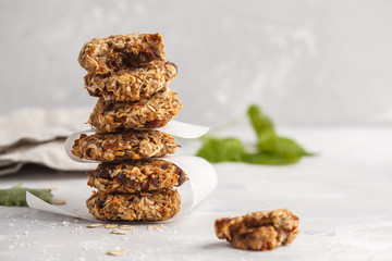 Aluminium Prints Cookies Vegan oatmeal cookies with dates and a banana. Healthy vegan detox dessert on a light background, copy space