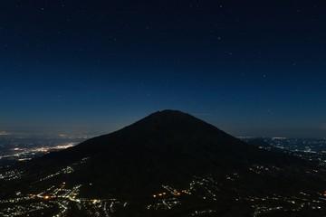Night Merbabu volcano at Java island in Indonesia, from the slopes of Merapi volcano. Version 2.