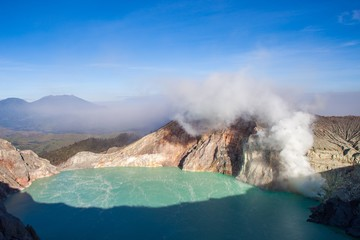 Colorful Ijen volcano crater lake and Raung volcano at the background. Indonesia. Version 2.