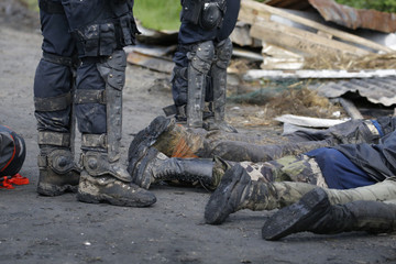 French gendarmes apprehend protesters during clashes in the zoned ZAD (Deferred Development Zone) in Notre-Dame-des-Landes