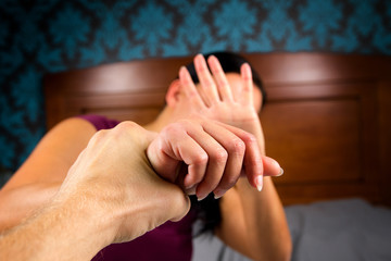 Wife with aggressive husband in domestic violence.