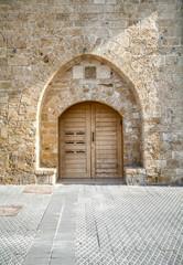 Fototapeta Vintage wooden double door in Old Jaffa port, Israel