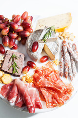 Food tray with charcuterie assortment, cheese  and grapes