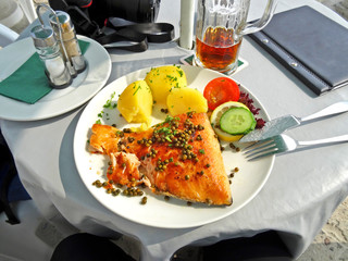 Sweet potatoes, salad and freshly caught sea fish, traditional cuisine in Germany