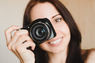 Young smiling brunette girl with camera