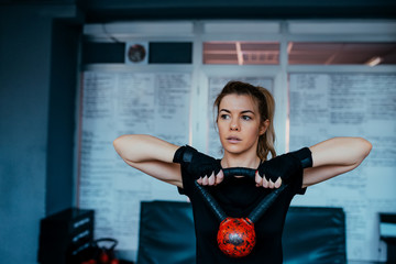 Beautiful woman training with the kettlebell.