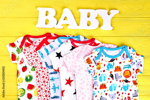 9ccdc922dfc Baby soft fashion clothes background. Infants collection of rompers ...