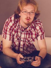 Gamer man playing using gaming pad