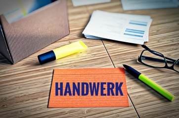 Index cards with legal issues with glasses, pen and bamboo with the german word Handwerk in english craft