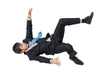 Businessman is falling down. Isolated on white background.