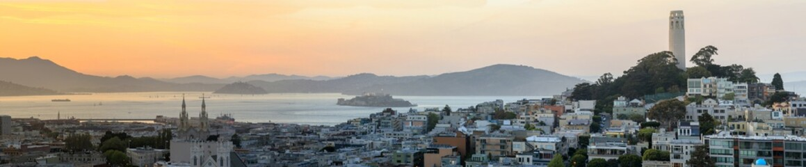 Sunset panoramic views of Telegraph Hill and North Beach neighborhoods with San Francisco Bay, Alcatraz and Angel Islands as well as Marin Headlands. San Francisco, California, USA.