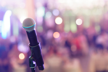 Close up microphone on stage in concert hall restaurant or conference room. Blurred background. Copy space