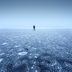 winter landscape with fog on the ice / patterns on the ice surface