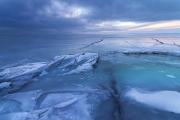 dawn on a frozen lake / icy landscape Ukraine winter