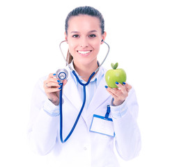 Medical doctor woman examining apple with stethoscope. Woman doctors