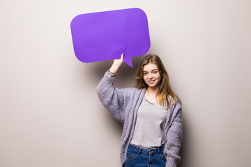 Young beautiful girl holding a purple bubble for text, isolated on a white background