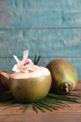 Fresh green coconuts on wooden table